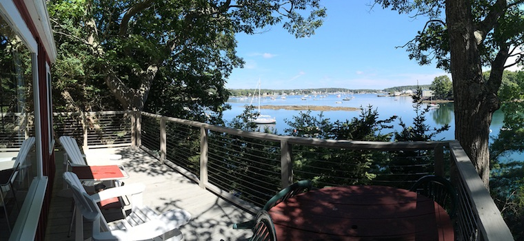 Sit back, relax, and enjoy the view from the deck of the Rock Cottage at Harborfields Waterfront Vacation Cottages in West Boothbay Harbor, Maine.